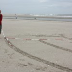 Drawing the Four Winds with rake. Kijkduin 2012